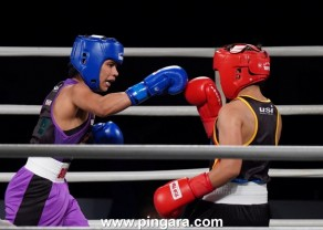 Nikhat Zareen of NE Rhinos throws a right at her opponent during the Big Bout Indian Boxing League 2019.jpg