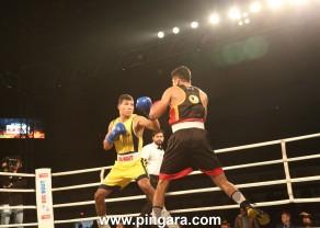 Odisha Warriors' Jakhongir Rakhmonov (yellow) in action against Bengaluru Brawlers' Dinesh Dagar during the Big Bout Indian Boxing League in Delhi's Indira Gandhi Indoor Stadium today (1).JPG