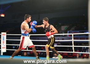 Punjab Panthers' A. Khalakov (R) in action against Gujarat Giants' Chirag during the finals of the Big Bout Indian Boxing League.JPG