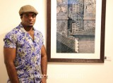 Santhosh_Andrade_with_Prize_Winning_Painting.jpg